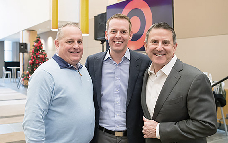 Shipt CEO and founder Bill Smith (center) with Target Chief Operating Officer John Mulligan (left) and CEO Brian Cornell